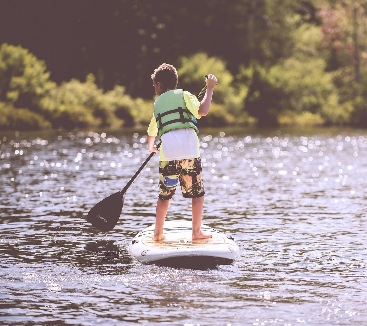 Stand up paddling kid